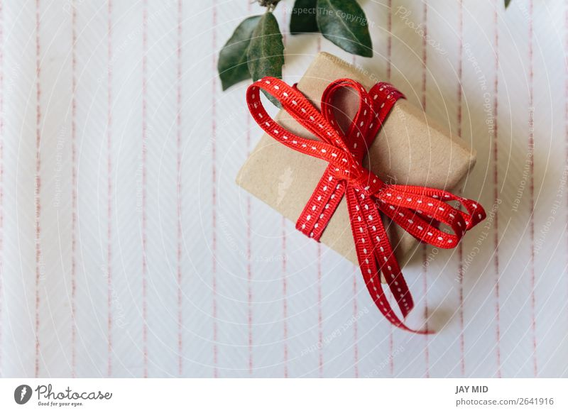 Gift box, wrapped in recycled paper and red bow Red Retro Elegant Birthday Shopping Paper String Symbols and metaphors Tradition Cloth Surprise