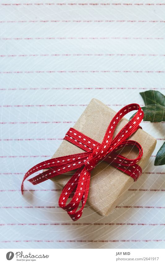 Gift box, wrapped in recycled paper and red bow Christmas & Advent Red Retro Elegant Birthday Shopping Paper String Easter Symbols and metaphors Tradition Cloth