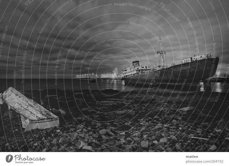 panteón Sky Clouds Horizon Beach Ocean Traffic accident Navigation Fishing boat Watercraft Dark wreck stones grounded Black & white photo Exterior shot Deserted