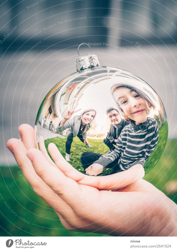 Family in Christmas tree ball Winter Human being Masculine Feminine Child Boy (child) Woman Adults Man Parents 3 8 - 13 years Infancy 30 - 45 years