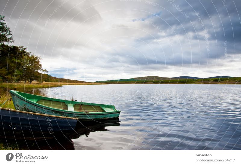 boat Sky Nature Blue Water Green Clouds Landscape Lake Weather Natural Elements Lakeside Storm clouds Rowboat