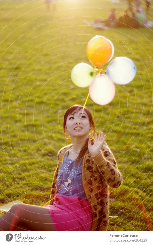 Spring Spring Spring XI Young woman Youth (Young adults) Woman Adults Hand 1 Human being 18 - 30 years Joy Balloon Asians Park Meadow Spring fever Sit Playing