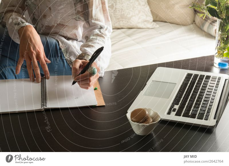 Woman hands writes a pen in a notebook, computer keyboard Lifestyle Work and employment Office Business Computer Technology Human being Adults Hand Paper Pen