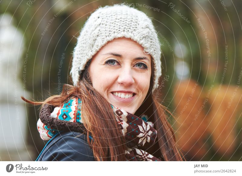 young beautiful woman in cold winter weather in park Lifestyle Happy Face Vacation & Travel Adventure Freedom Winter Winter vacation Woman Adults Nature