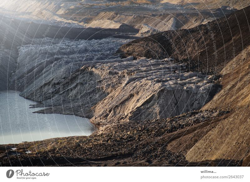 overburden heaps with lake in open pit mining Energy industry Renewable energy Energy crisis Environment Landscape Climate change Lake Bizarre Emphasis