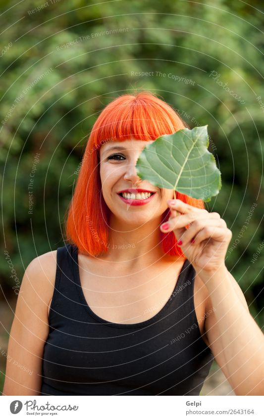 Red hair girl with a tree leaf Lifestyle Happy Beautiful Face Make-up Human being Woman Adults Nature Autumn Leaf Park Forest Fashion Smiling Happiness Colour
