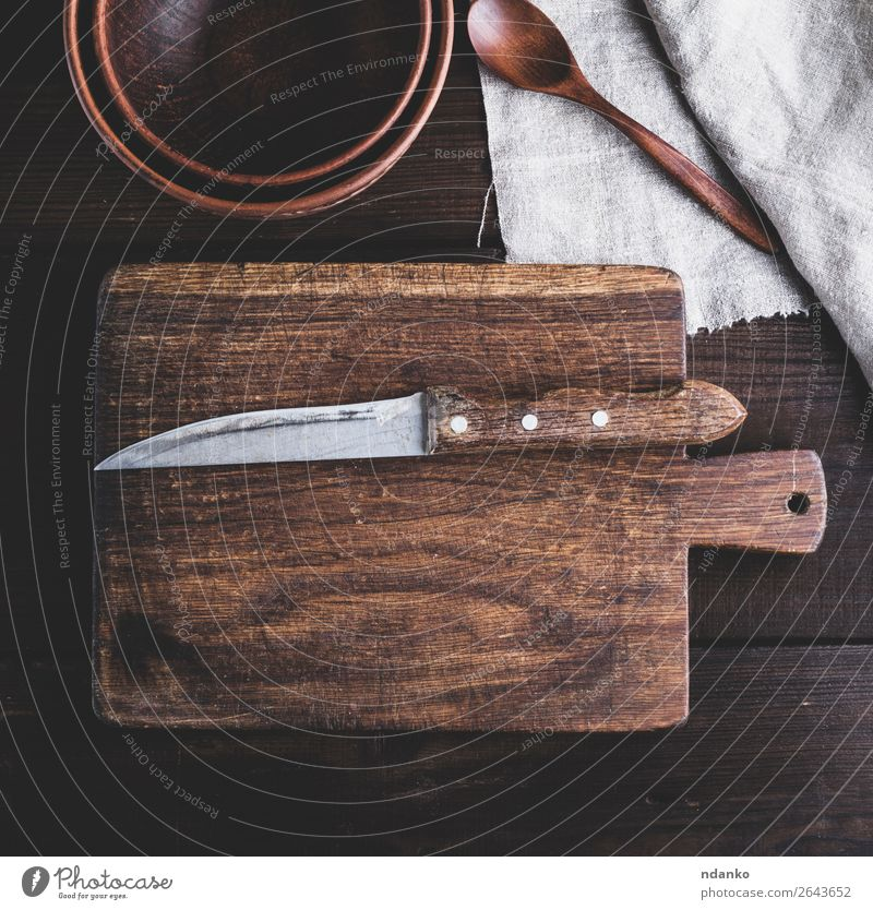 kitchen brown cutting board with handle and knife Plate Bowl Knives Kitchen Nature Wood Old Retro Brown background Blank chopping cook cooking Cut empty food