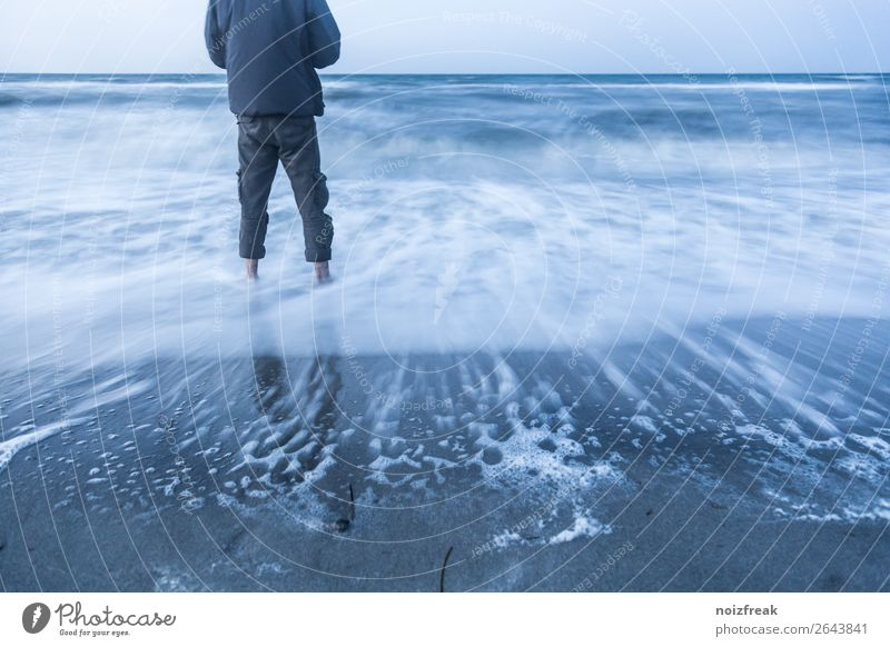 Human being Youth (Young adults) Blue Water Ocean Relaxation Calm Beach 18 - 30 years Adults Life Gray Contentment Waves Stand Adventure