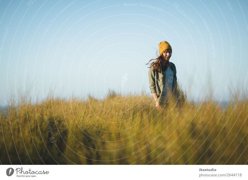 Yellow cap women Lifestyle Happy Beautiful Vacation & Travel Adventure Freedom Ocean Hiking Success Human being Woman Adults Nature Landscape Autumn Grass Coast