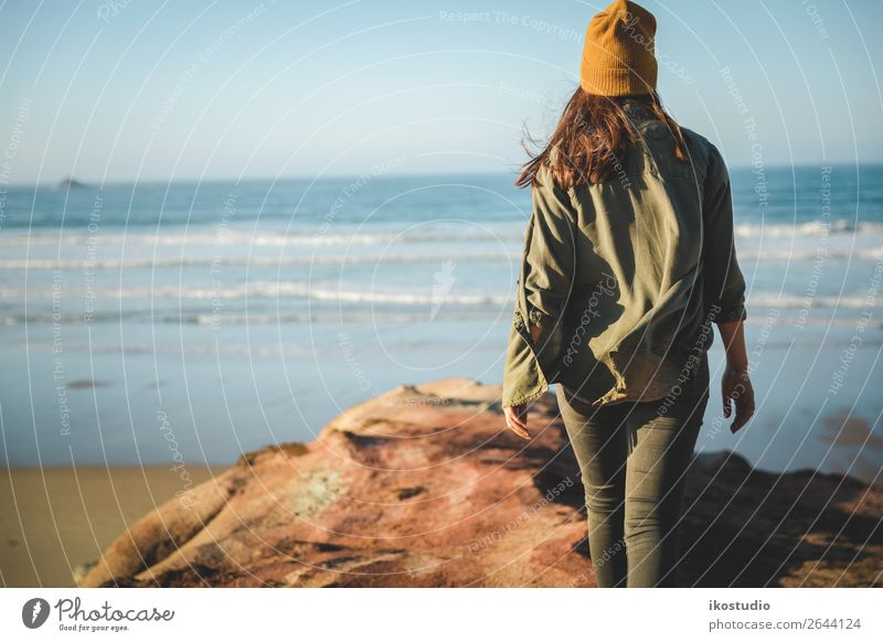 Yellow cap women Lifestyle Beautiful Vacation & Travel Adventure Freedom Beach Ocean Hiking Success Human being Woman Adults Nature Landscape Autumn Coast Blue