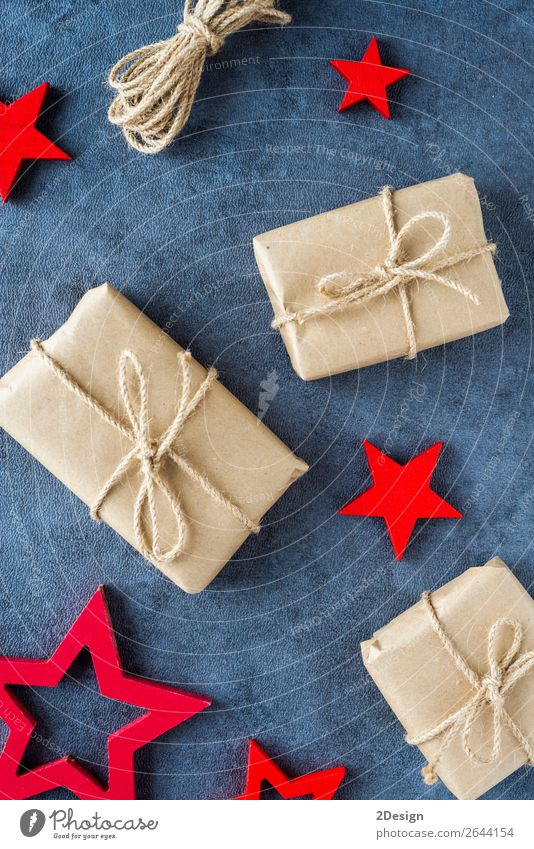 Some christmas presents in decorative boxes on a dark background Old Christmas & Advent Red Tree Winter Style Feasts & Celebrations Brown Above Design