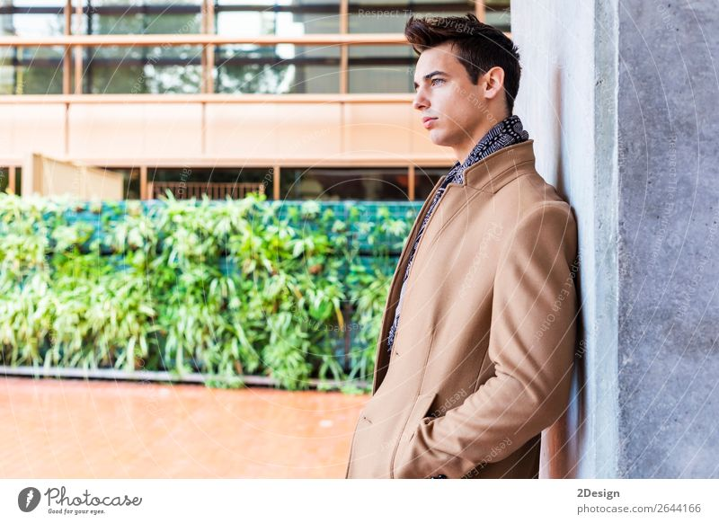 Young man wearing winter clothes in the street. Lifestyle Elegant Style Beautiful Hair and hairstyles Winter Human being Man Adults Youth (Young adults) Autumn