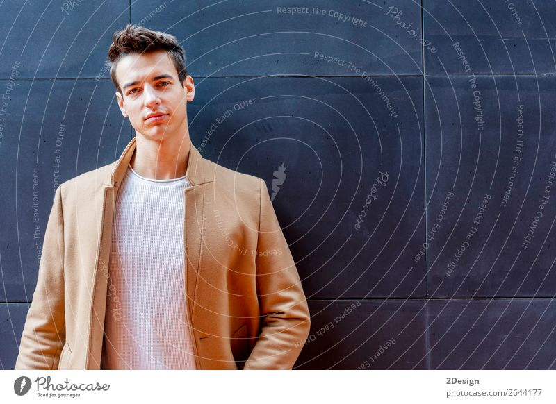 Young man wearing winter clothes standing in the street Lifestyle Elegant Style Beautiful Hair and hairstyles Winter Human being Man Adults Youth (Young adults)