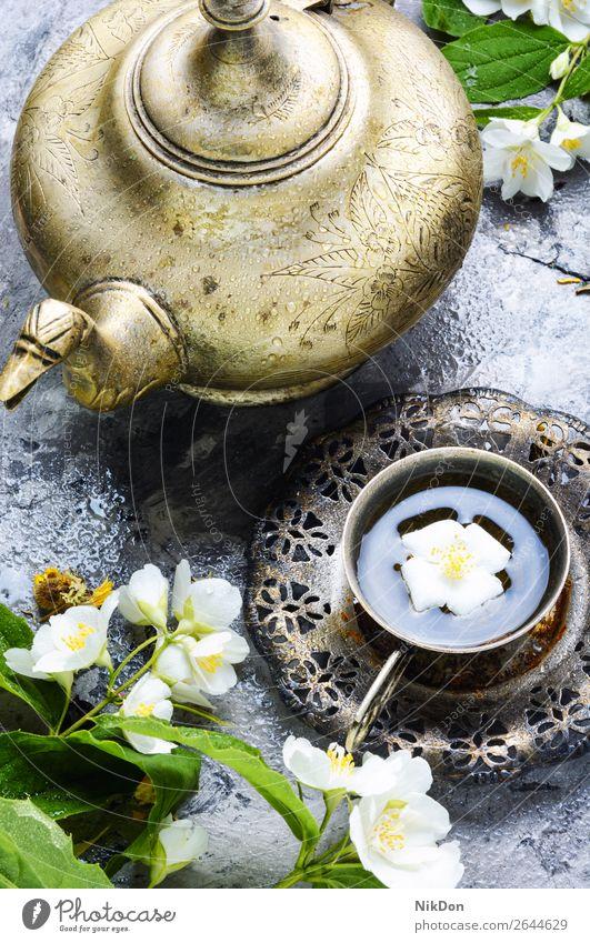 Tea with jasmine tea drink healthy herbal flower cup beverage green turkish eastern vintage arabic retro arabian ornament muslim jug islamic ritual moroccan