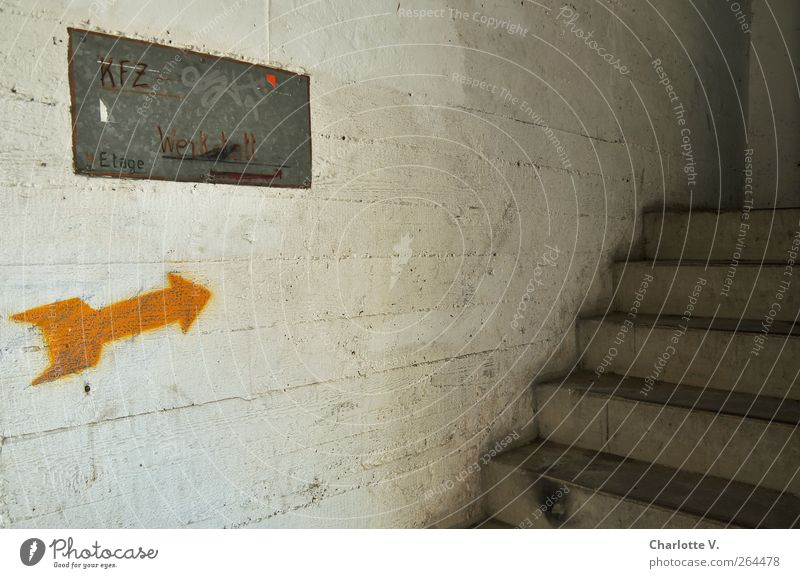 KFZ workshop Parking garage Wall (barrier) Wall (building) Stairs Concrete Metal Sign Characters Signs and labeling Arrow Dirty Dark Hideous Broken Trashy Gray