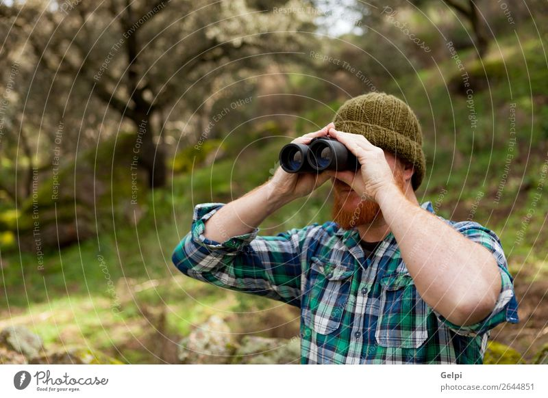 Young Man using binoculars Human being Vacation & Travel Nature Summer Beautiful Landscape Tree Forest Lifestyle Adults Autumn Natural Freedom Hiking