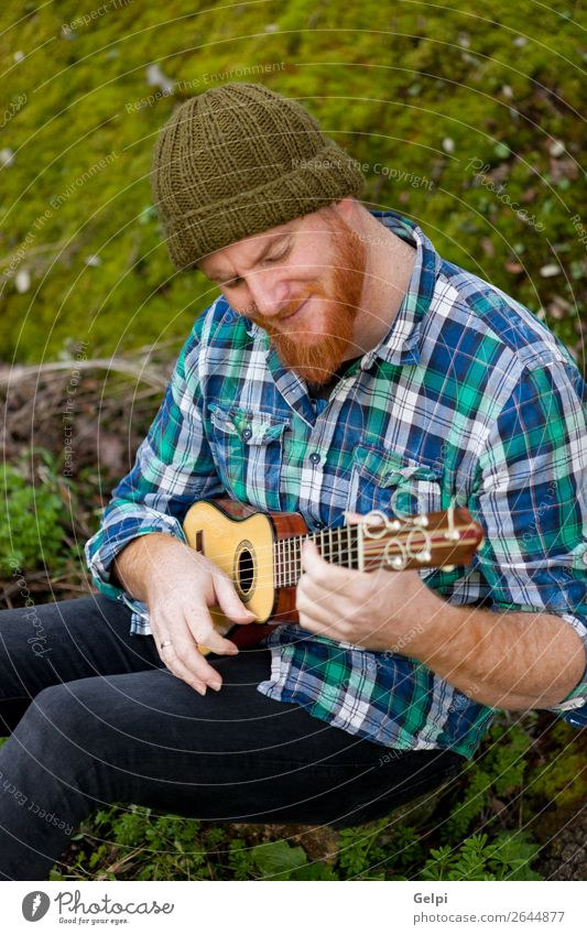 Hipster man with red beard playing a ukulele Leisure and hobbies Playing Entertainment Music Human being Man Adults Musician Nature Red-haired Moustache