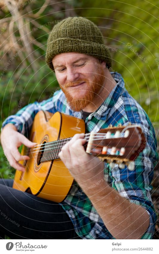 Hipster man with red beard playing a guitar Leisure and hobbies Playing Entertainment Music Human being Man Adults Musician Nature Red-haired Moustache