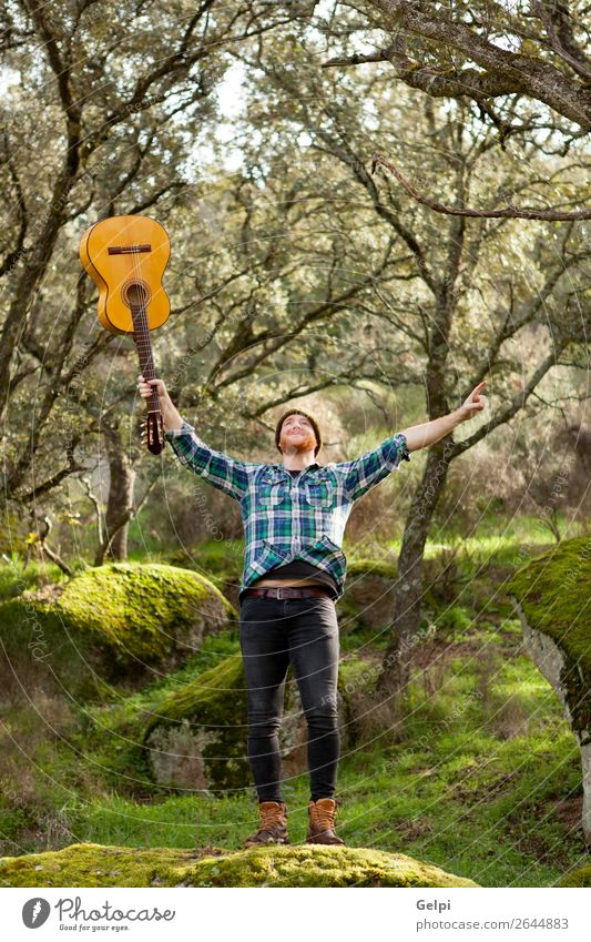 Happy hipster man with a guitar in the field Wellness Leisure and hobbies Playing Entertainment Music Success Human being Man Adults Musician Guitar Nature