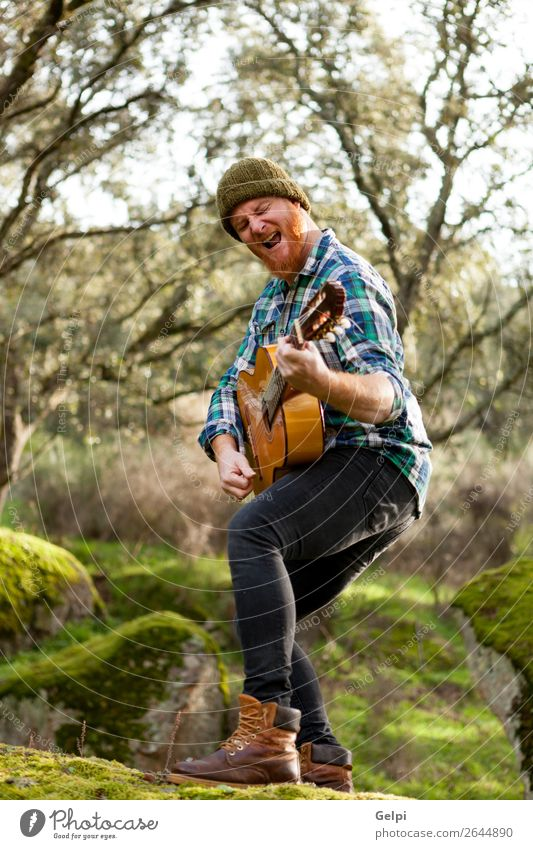 Guitarist with crazy face playing the guitar Leisure and hobbies Playing Entertainment Music Human being Man Adults Musician Nature Red-haired Moustache