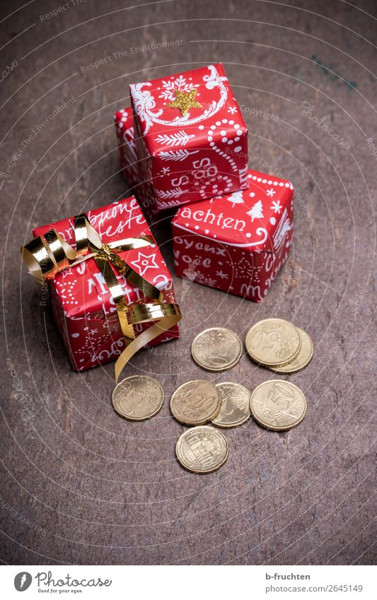 Christmas bonus Shopping Money Save Feasts & Celebrations Christmas & Advent Packaging Bow Solidarity Help Fairness Gift Donate Coin Poverty Joy Colour photo