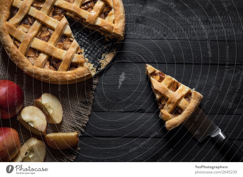 Kitchen table with an apple pie and a slice. Above view. Cake Dessert Candy Thanksgiving Christmas & Advent Delicious Retro Sweet Black Tradition