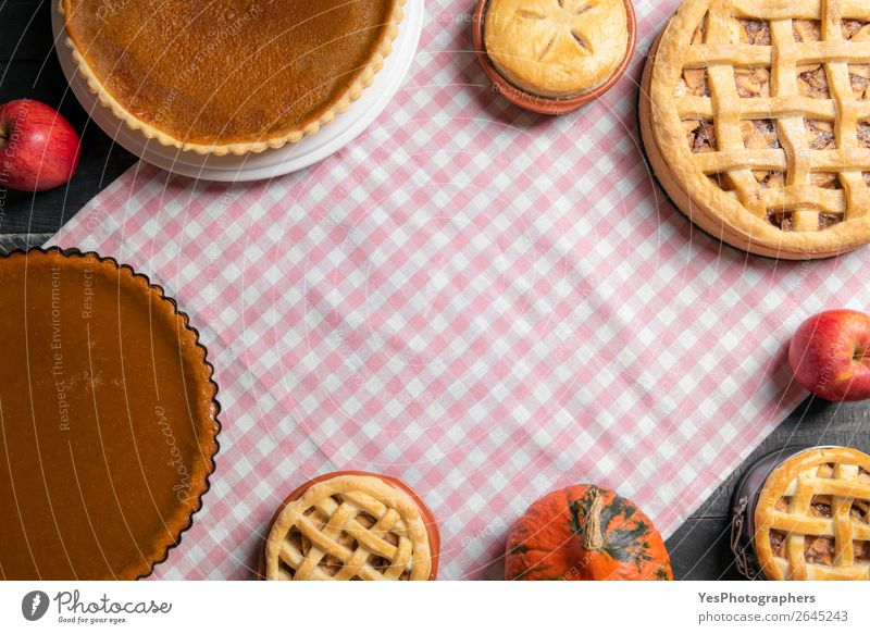 Table with many various sweet pies. Home baked pastry items. Cake Dessert Candy Kitchen Thanksgiving Exceptional Sweet Many Pink Tradition Thanksgiving day