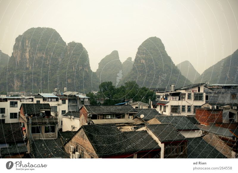 pick Nature Landscape Sky Clouds Horizon Hill Rock Mountain Peak karst mountains Yangshuo China Small Town Downtown Old town House (Residential Structure) Roof