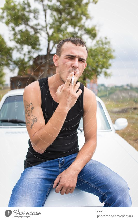 brutal guy with a tattoo smokes a cigarette Parenting Education Work and employment Profession Masculine Young man Youth (Young adults) 1 Human being