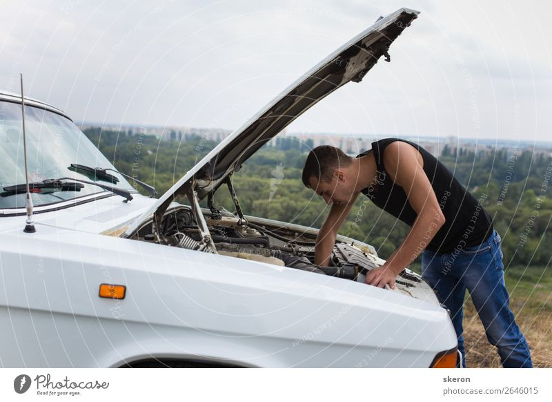 young guy repairing an old car Human being Nature Youth (Young adults) Young man Landscape Eroticism 18 - 30 years Street Lifestyle Adults Environment Sports