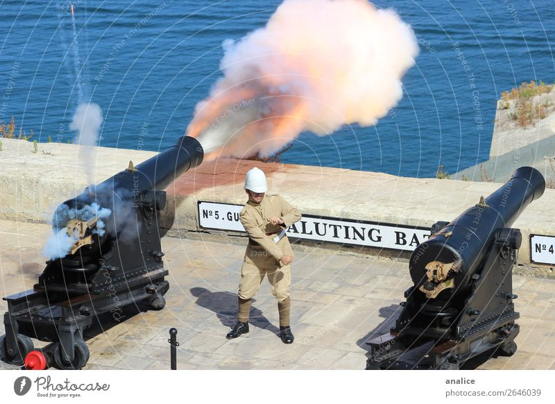 Saluting Battery Human being Youth (Young adults) 18 - 30 years Adults Feasts & Celebrations Masculine Europe Protection Safety Old town Smoke Watchfulness War