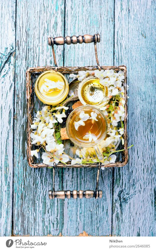 Tea with acacia flavor tea flower cup drink green table petal herbal tree nature leaf fresh spring healthy floral mug honey blossom glass concept natural bloom
