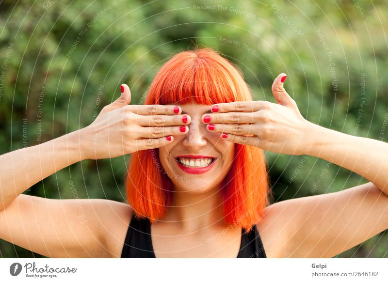 Red haired woman covering her eyes in a park Lifestyle Style Joy Happy Beautiful Hair and hairstyles Face Wellness Calm Playing Summer Human being Woman Adults
