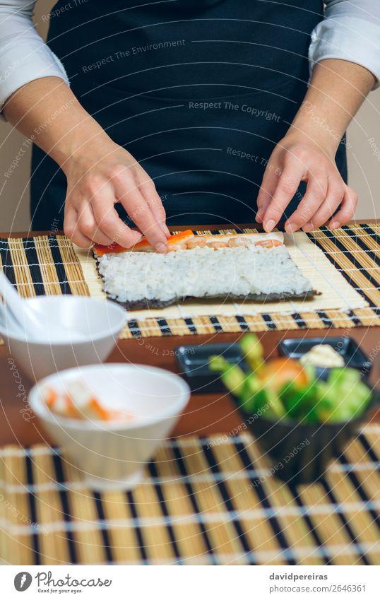 Chef hands placing ingredients on rice Seafood Diet Sushi Bowl Restaurant Human being Woman Adults Hand Make Fresh kitchener Putt crab stick prawn Rice maki