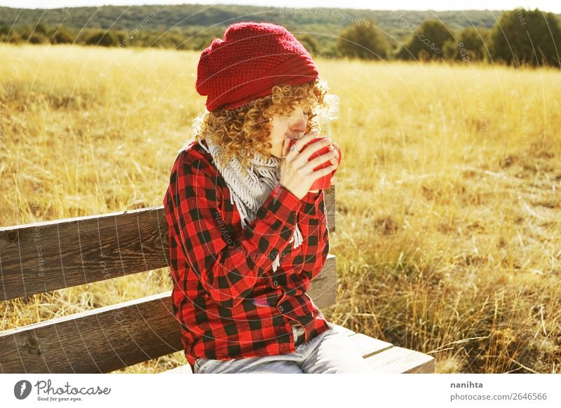 portrait of a young woman drinking coffee outdoors Woman Human being Youth (Young adults) Young woman Red Sun Relaxation Loneliness Calm Healthy 18 - 30 years