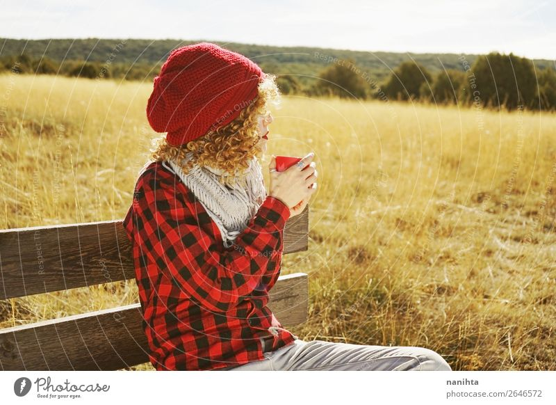 A young woman taking a cup of tea Woman Human being Nature Youth (Young adults) Young woman Red Relaxation Loneliness Calm Joy 18 - 30 years Lifestyle Adults
