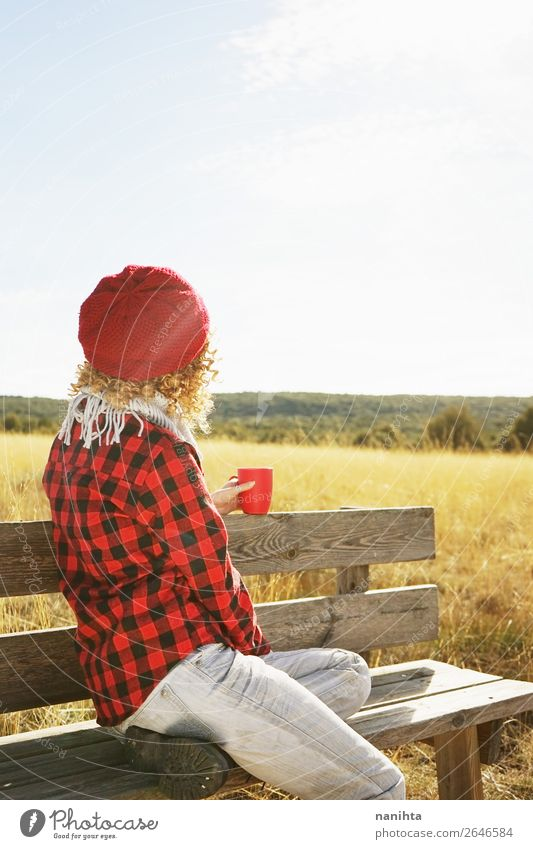 A young woman from behind in red plaid shirt Breakfast Drinking Hot drink Coffee Tea Lifestyle Healthy Wellness Relaxation Calm Vacation & Travel Freedom
