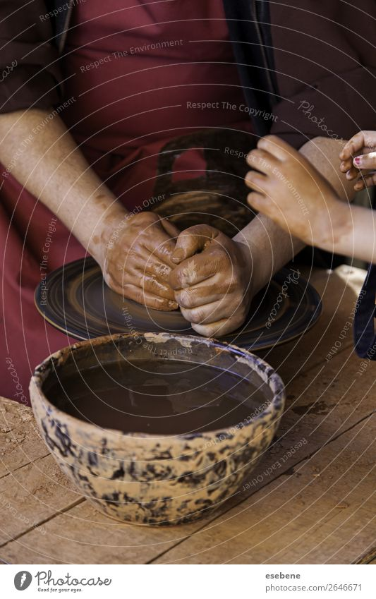Hands of a potter forming clay Bowl Pot Handicraft Child Work and employment Craft (trade) Human being Woman Adults Fingers Art Culture Touch Make Dirty Wet