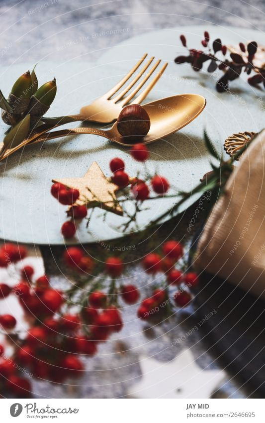 christmas table setting, golden cutlery and nandinas Dinner Plate Fork Spoon Winter Decoration Table Restaurant Thanksgiving Christmas & Advent New Year's Eve