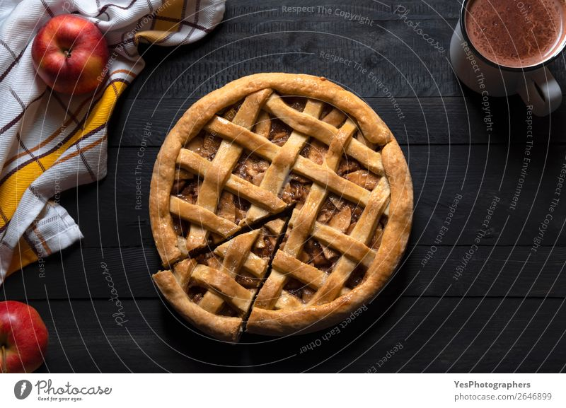 Apple pie and slice on a black table. Top view. Savory pastry. Black Wood Sweet Retro Table Candy Cake Tradition Dessert Breakfast Meal Rustic Baking Vertical