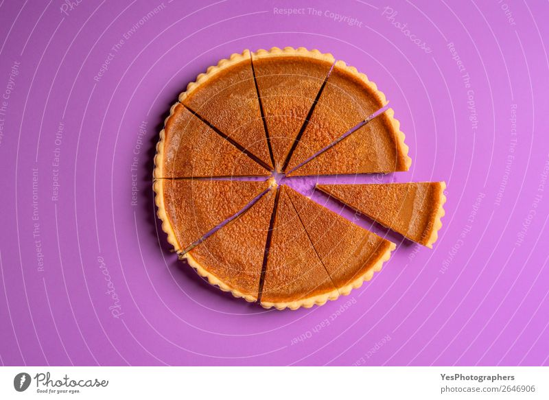 Sliced pumpkin pie and a separate piece. Top view. Copy Space Sweet Candy Cake Violet Tradition Dessert Conceptual design Baking Divide Home-made American Tasty