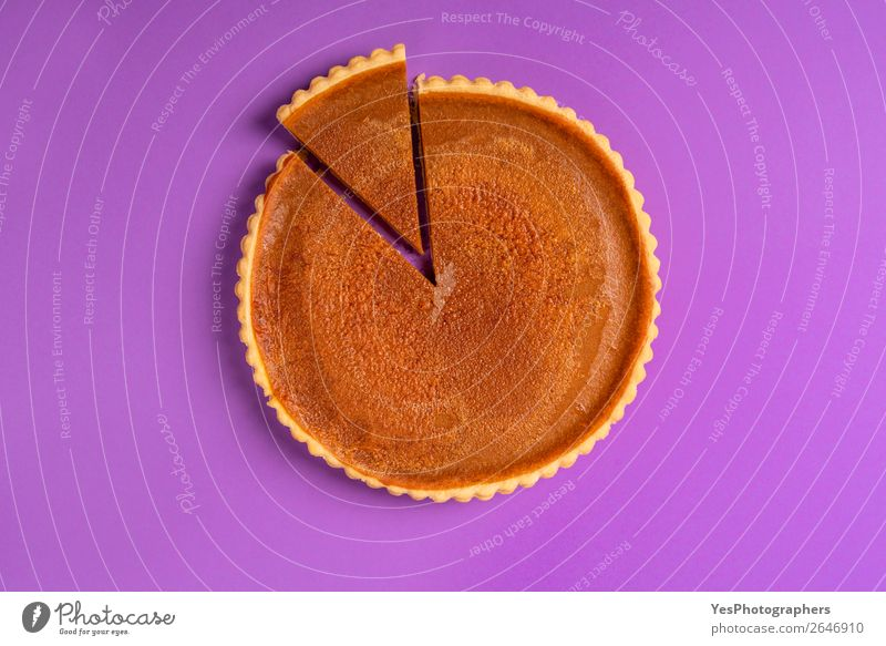 Whole pumpkin pie with a cut slice. Above view. Cake Dessert Candy Winter Feasts & Celebrations Thanksgiving Christmas & Advent Autumn Tradition Divide