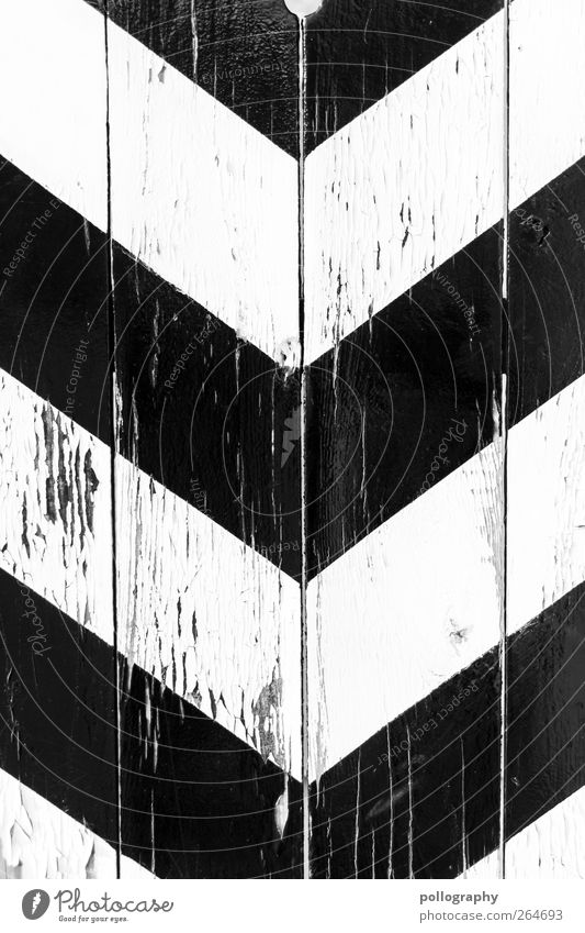 down Wall (barrier) Wall (building) Facade Door Sign Signage Warning sign Line Arrow Sharp-edged Black White Movement Resolve Symmetry Lanes & trails Target