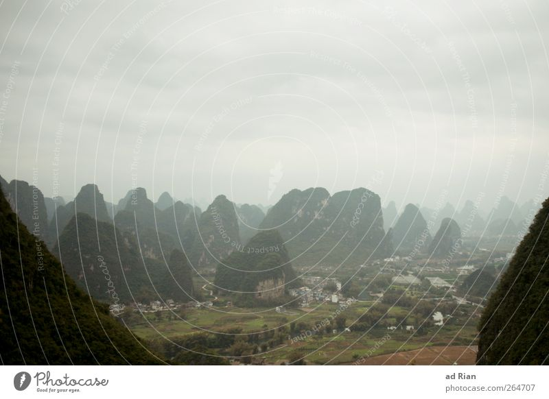 karst region Nature Landscape Clouds Hill Rock Mountain karst landscape Peak Yangshuo China Beautiful Colour photo Copy Space top Silhouette Bird's-eye view