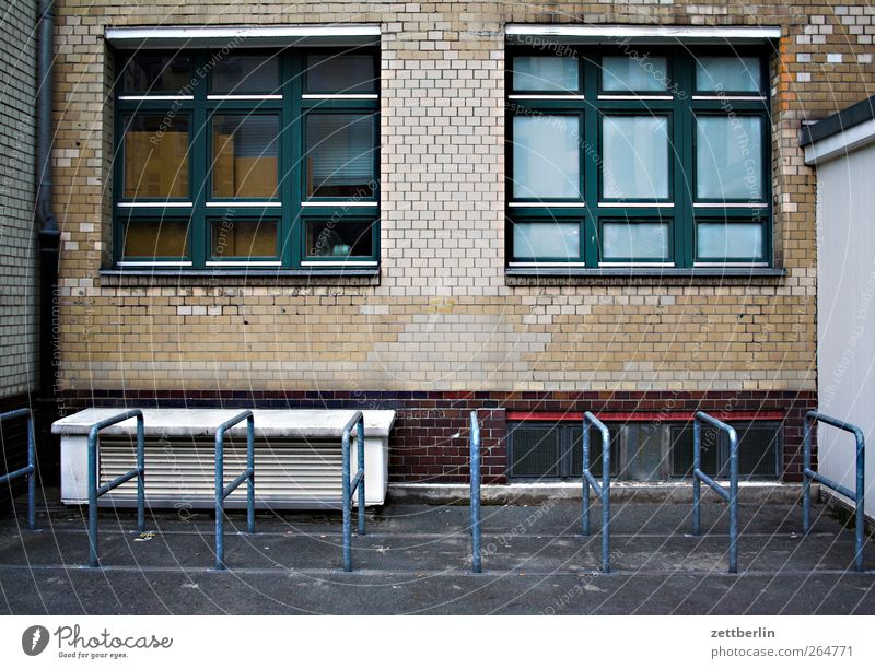 Bicycle stand (empty) Town Manmade structures Building Architecture Wall (barrier) Wall (building) Facade Window Wait Bicycle rack Empty Gloomy Colour photo