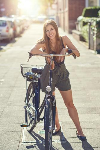 Attractive friendly young woman with her bicycle Lifestyle Joy Happy Beautiful Leisure and hobbies Summer Sports Woman Adults 1 Human being 18 - 30 years