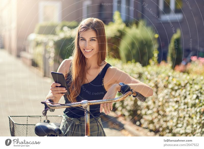 Beautiful woman with bicycle and smartphone Happy Face Summer Business PDA Technology Woman Adults 1 Human being 18 - 30 years Youth (Young adults) Warmth