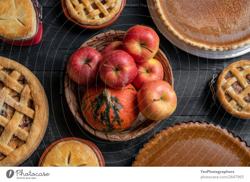 Basket with fruits and many sweet pies. Top view. Fruit Apple Cake Dessert Candy Table Kitchen Thanksgiving Christmas & Advent Wood Exceptional Retro Sweet Many