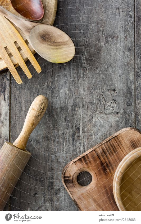 Cooking wooden utensils on wooden background Chopping board Crockery Ladle Wood Food Healthy Eating Food photograph Object photography Kitchen Equipment Surface