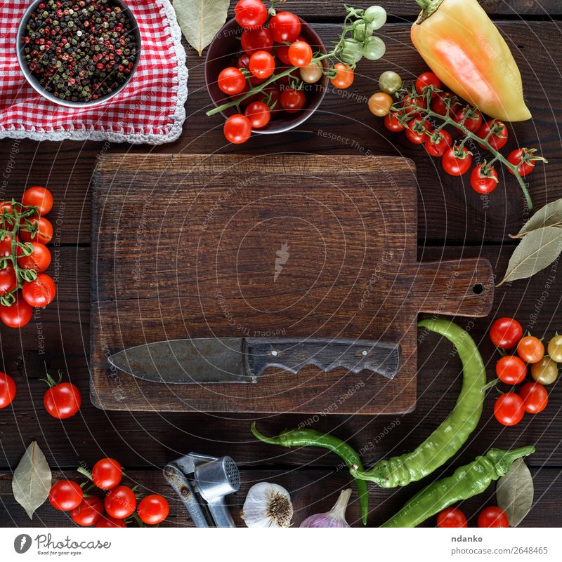 empty kitchen cutting and fresh red cherry tomatoes Vegetable Herbs and spices Nutrition Lunch Vegetarian diet Knives Table Kitchen Wood Eating Fresh Above